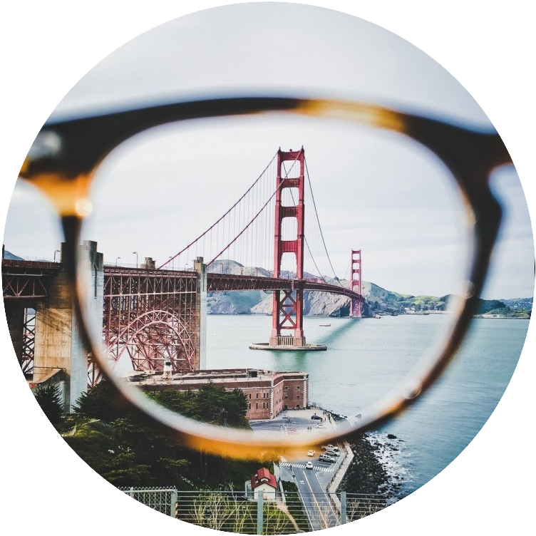 Photo of Golden Gate bridge looked at through a pair of glasses.