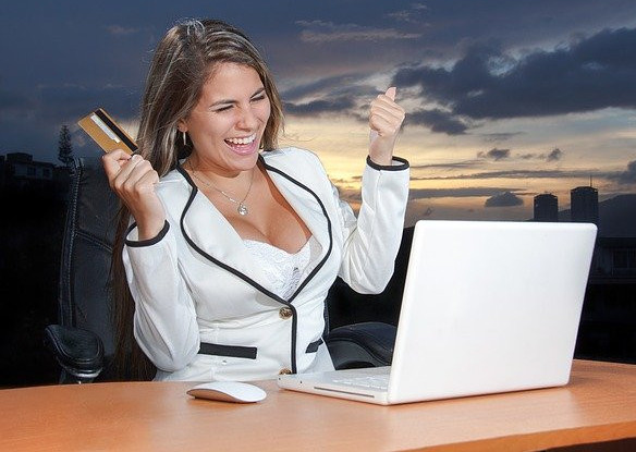 """<img src="""" lady celebrating in front of computer.jpg"""" alt=""""how to work for money online""""/>"""