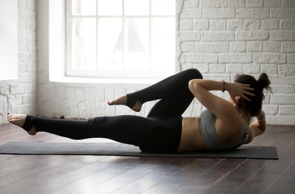 "<img src= ""woman performing bicycle sit-ups.jpg"" alt=""how to reduce mommy belly""/>"