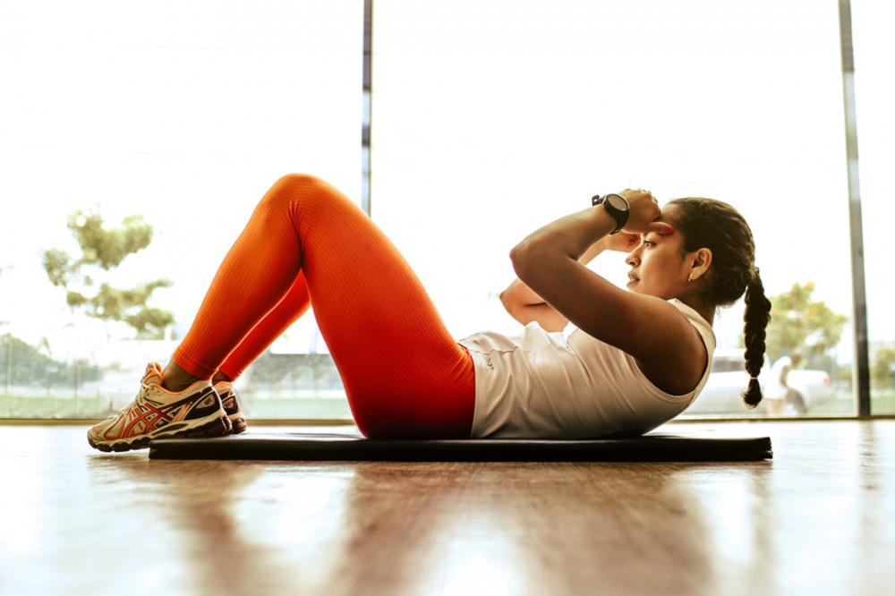 "<img src=""lady performing stomach exercise on mat.jpg"" alt=""10 best workout programs""/>"