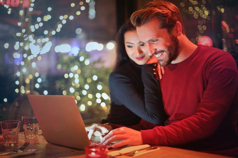 """<img src=""""man and woman looking at laptop.jpg"""" alt=""""how to build a business on a budget""""/>"""