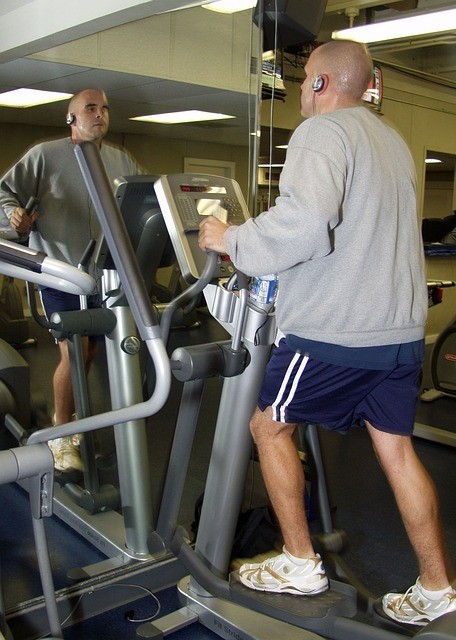 "<img src=""man on treadmill in gym.jpg"" alt=""how many days a week you should workout""/>"