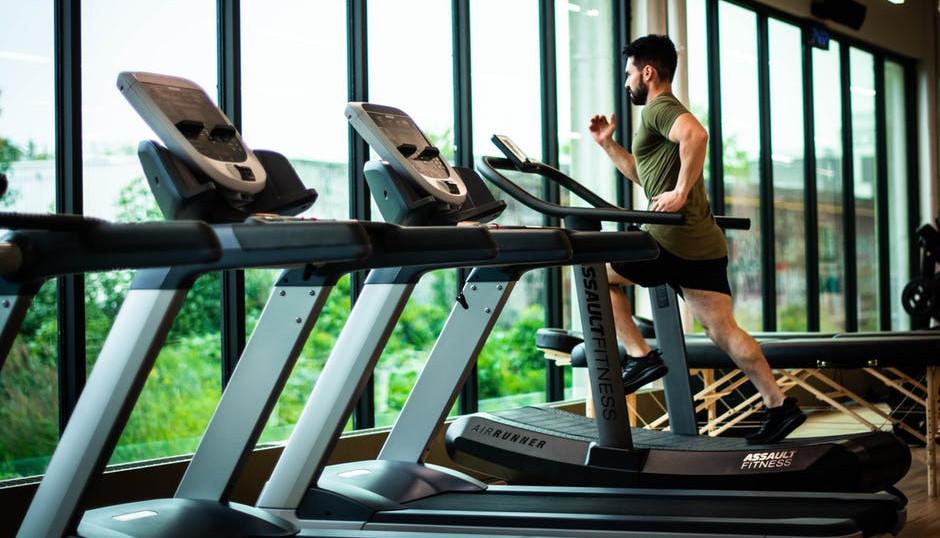 """<img src=""""man running on treadmill.jpg"""" alt=""""best exercise equipment for weight loss""""/>"""