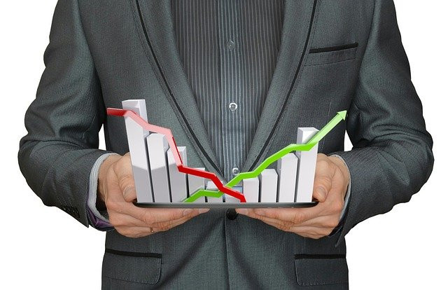 """<img src=""""man holding a graph showing growth.jpg"""" alt=""""starting your business plan""""/>"""