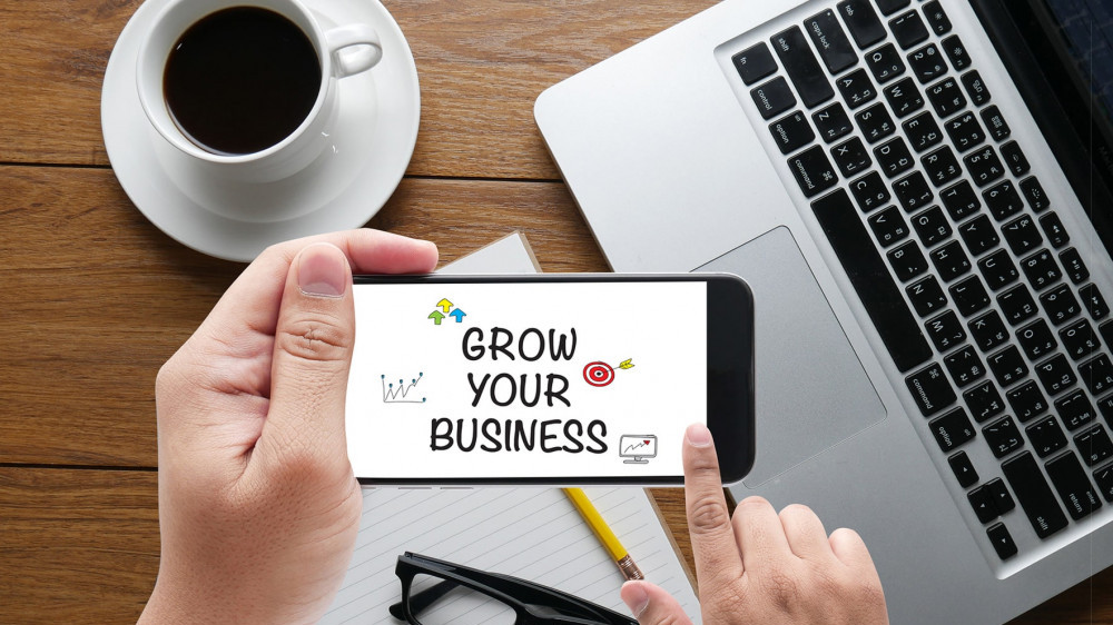 """<img src= """"someone looking at mobile device.jpg"""" alt= """"how to start in a online business""""/>"""
