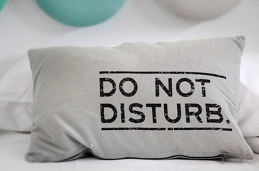 Pillow with text Do Not Disturb