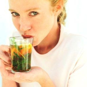 Woman drinking a cup of green tea