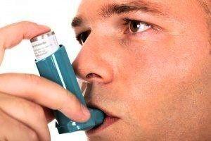 asthma man with inhaler