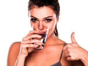drinking water is good for the skin.(Woman drinking water)
