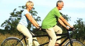 Healthy Lifestyle couple on a bicycle