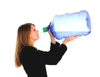 too much water to drink woman drinking of a 20 ltr bottle