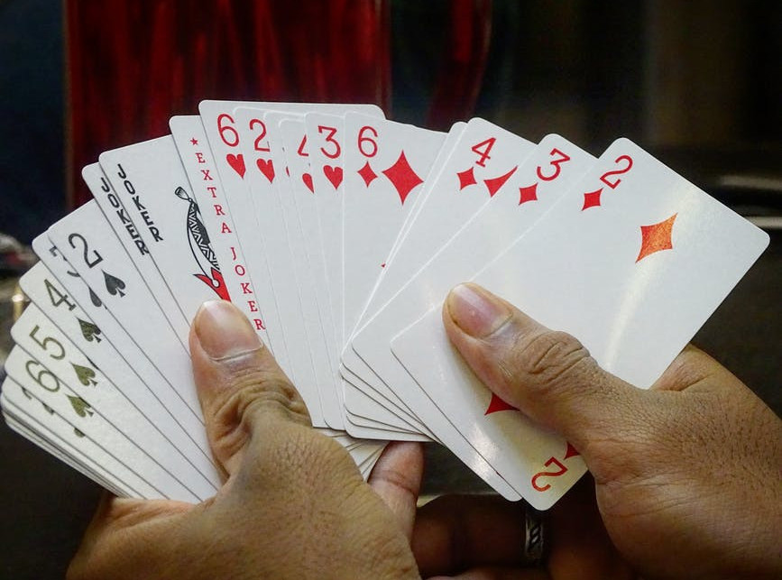 Full Deck Of Cards in Hands