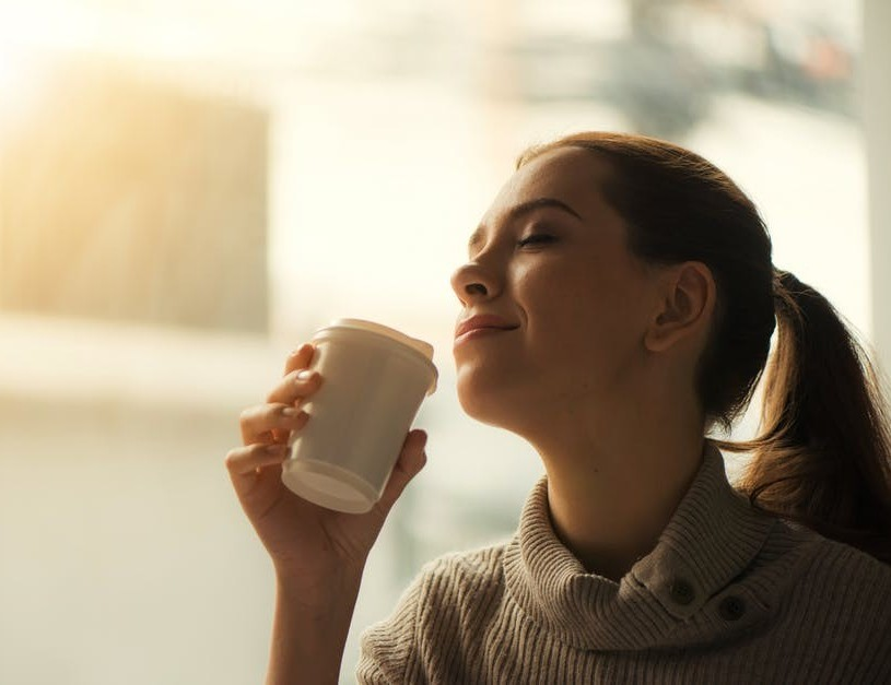 woman enjoying a freshly brewed cup of coffee