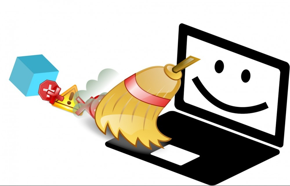 smiling laptop being swept with a broom