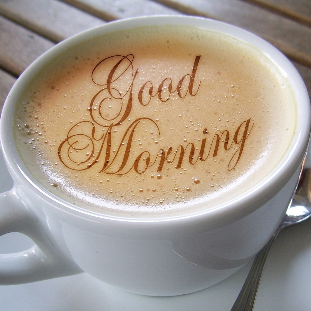 cup of coffee that has the words good morning on the top