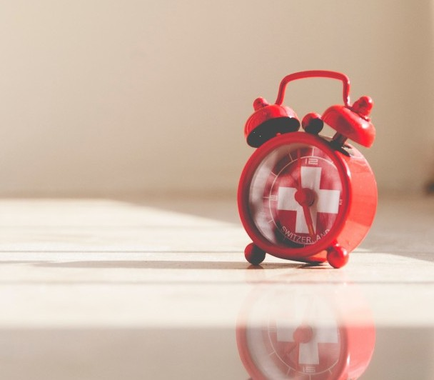 small round red alarm clock