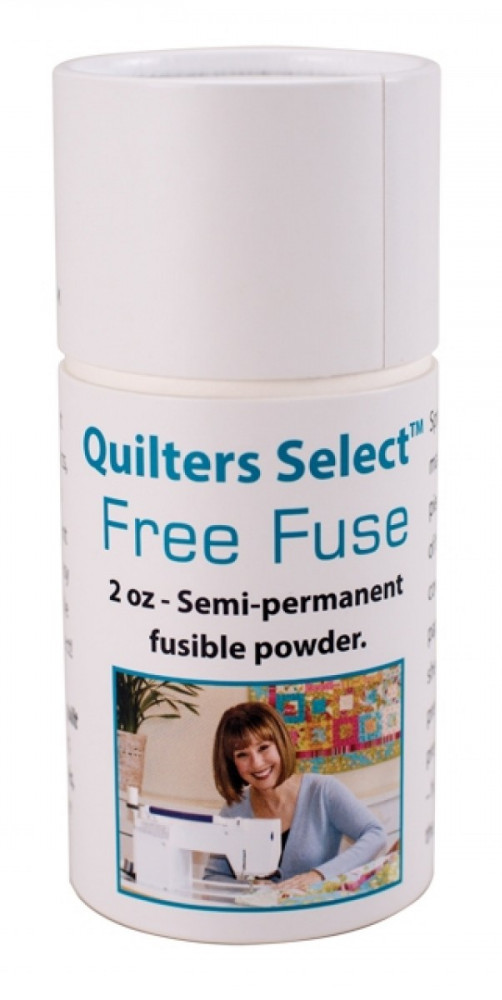 Quilter's Select Free Fuse used as a basting tool when making a quilt sandwich