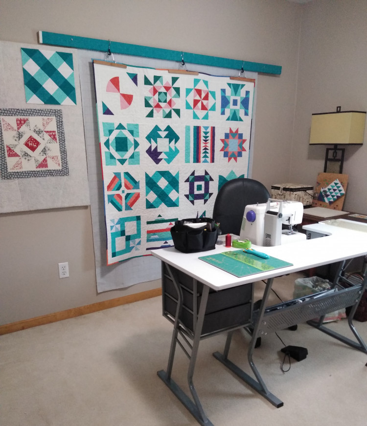 Sewing room with sewing table, design wall