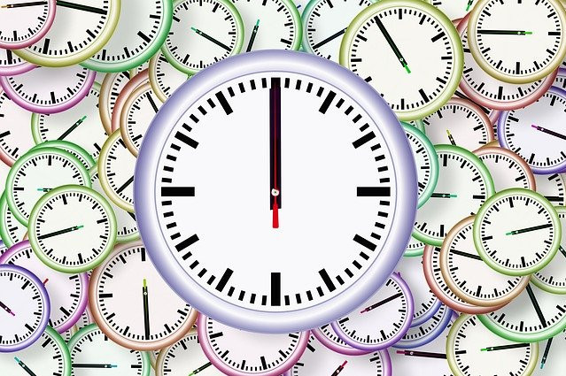 Round clock faces in various pastel colors
