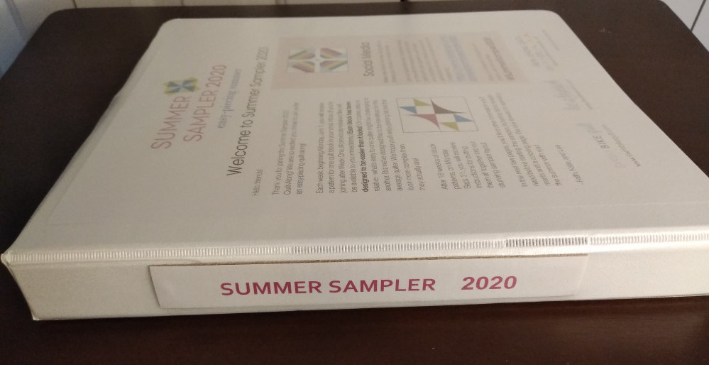 Three ring binder used to store and organize quilt block patterns and instructions for Summer Sampler 2020