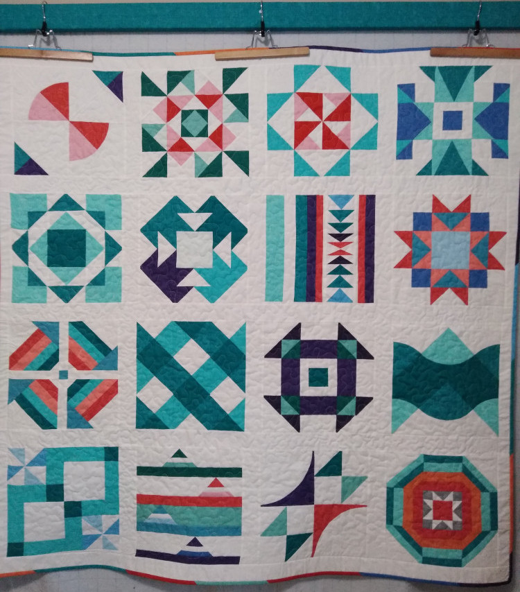 Summer Sampler quilt completed fall 2020 using fabrics from the Robert Kaufman Quilter's linen fabric line.