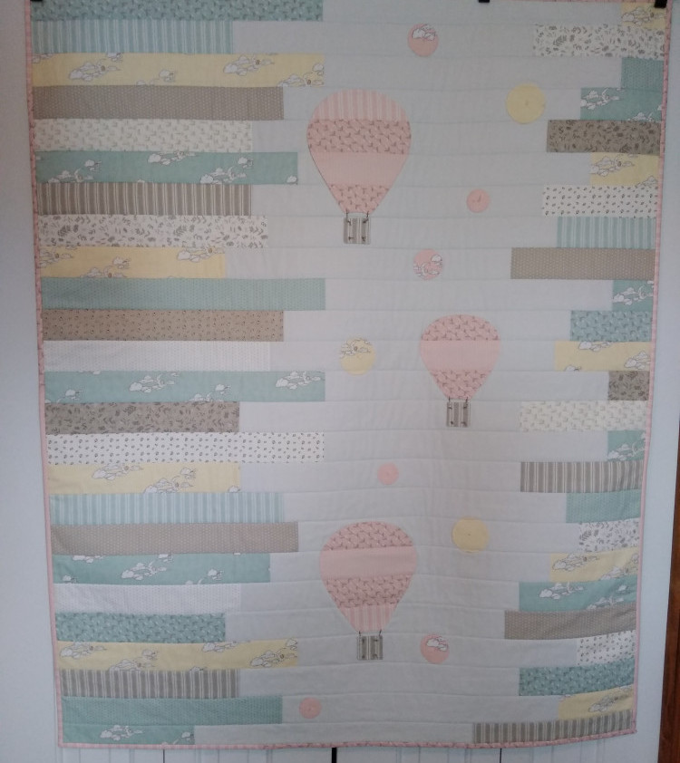 Up In the Air Baby Quilt made with jelly roll fabric from Hushabye Hollow fabric line