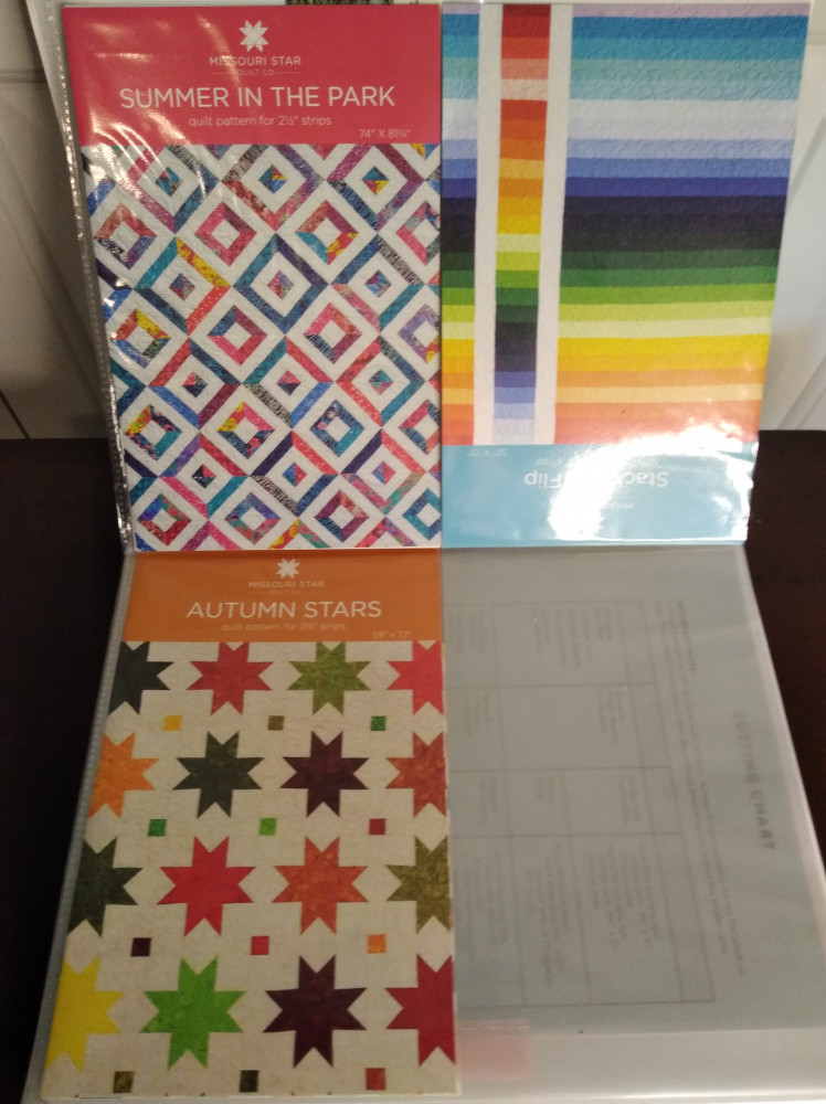 Missour Star Co. Quilt patterns stored in clear sheet protectors in a three ring binder