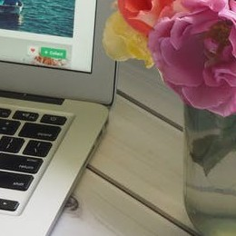 laptop on desk with flowers
