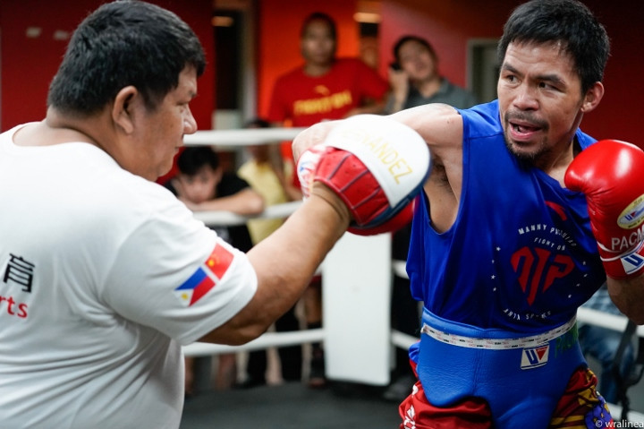 Pacquiao doing pad work