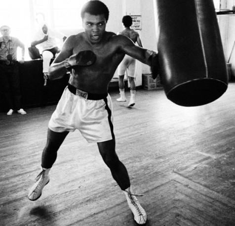Muhammad Ali using the heavy bag