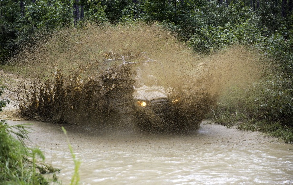 UTV Splashing Through Mud Hole