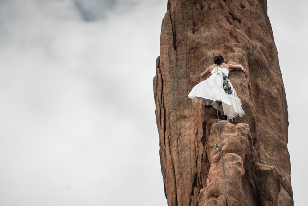 girl climbing steep mountain