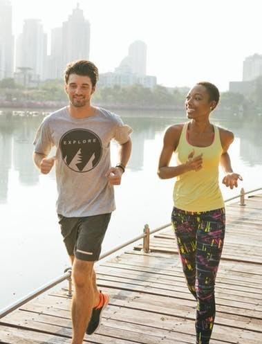 man and lady exercising as a way to look younger,