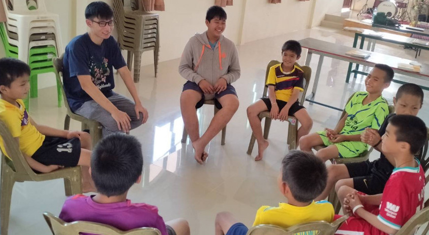Obey leading his students to practice English conversation during BBL class.