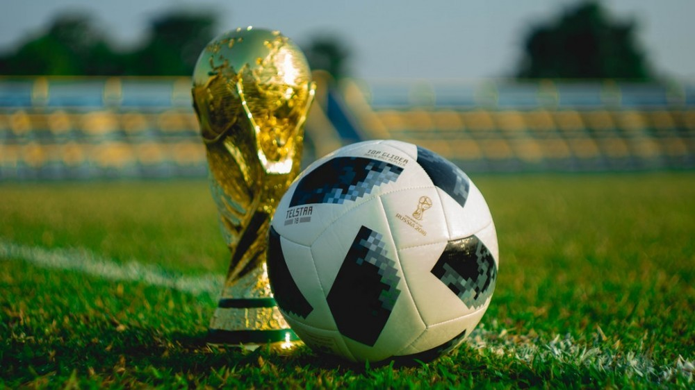 Soccer World Cup trophy and a soccer ball