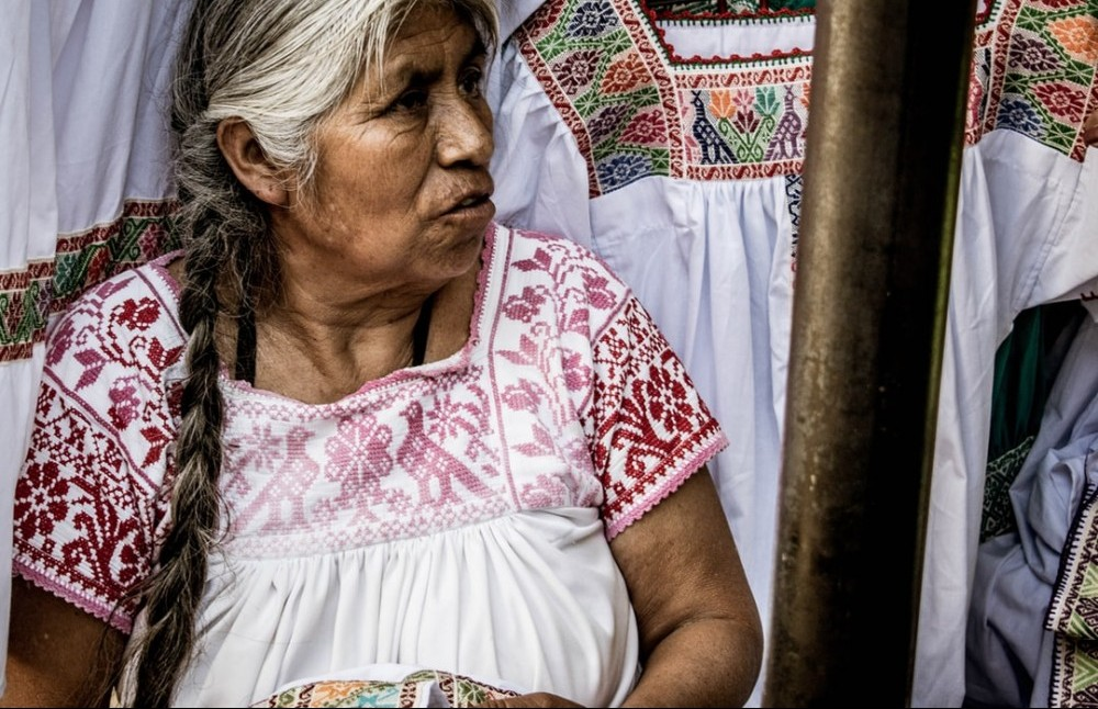 Old woman dressed in typical Mexican clothes.