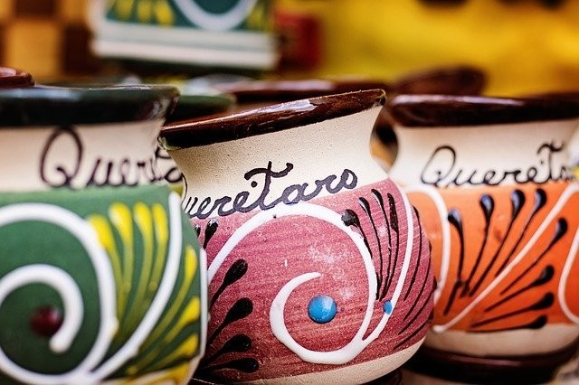 Three colorful jugs with the word Queretaro written on them.