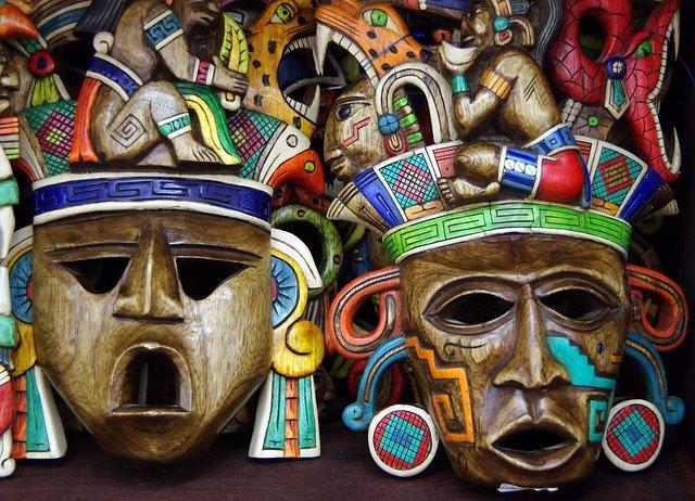 Two colorful Maya masks.