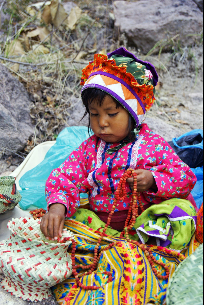 Little girl dressed in typical Tarahumara clothing.