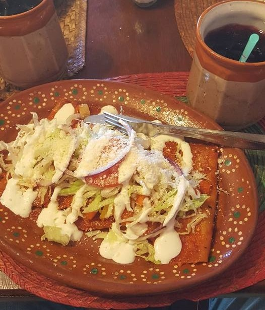 Enchiladas mineras plate with hibiscus tea.