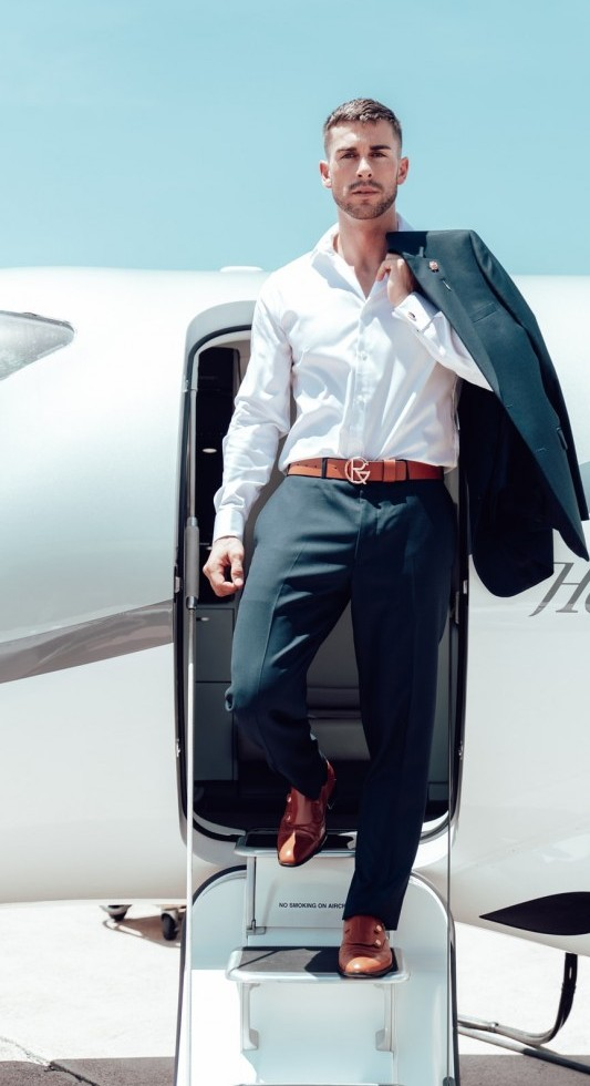 A man coming out of an airplane jet set lifestyle