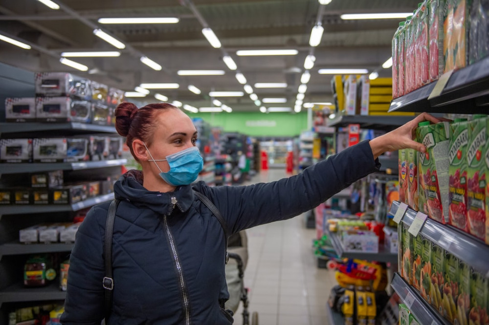 what-is-the-cost-of-living-in-Crete-woman-picking-products-in-supermarket