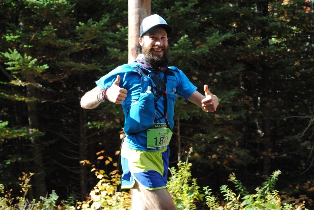 Two thumbs up to let them know I am 'okay' on my coconut water, feeling great at 18 mi in!