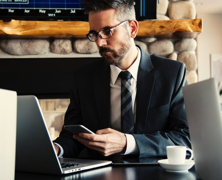 business man working texting on a laptop