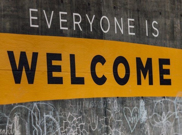 A sign saying everyone is welcome