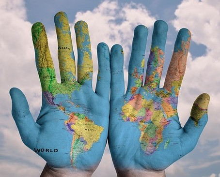 The world map on a pair of hands