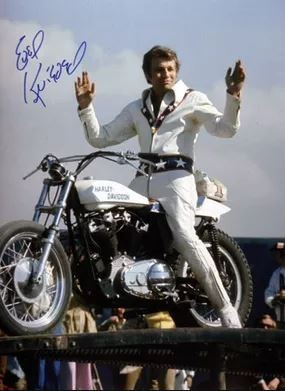 Evel Knievel sat on his bike