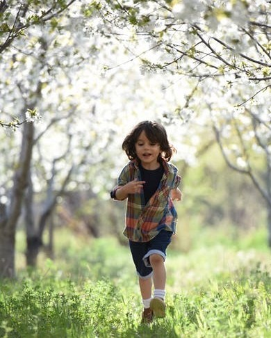 Boy running outdoors in nature, wonderful strategy to include for assisting self-regulation.