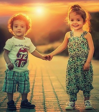 Brother and sister smiling and holding hands. Example of happy children, self-regulating :)