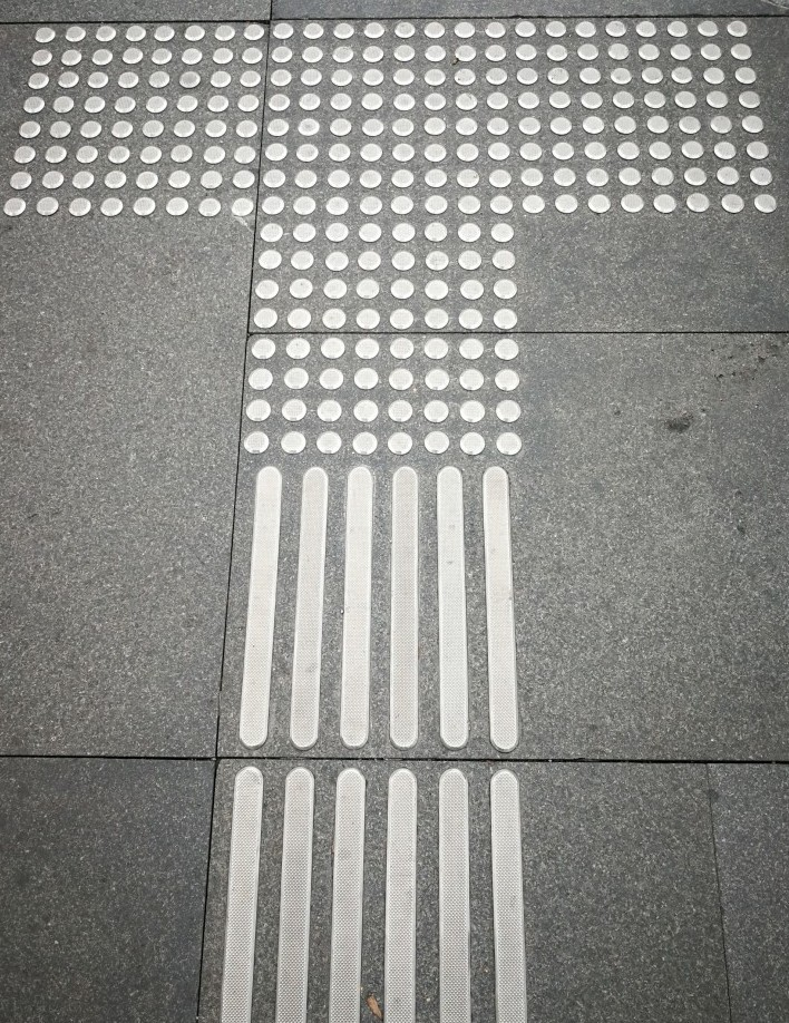 pedestrians tram line guide for the blind